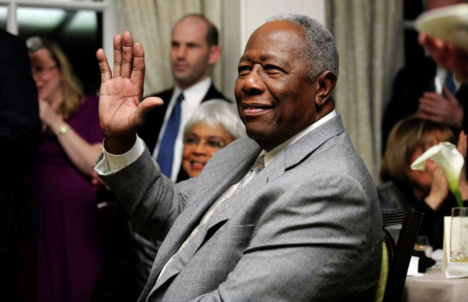 FILE - In this  Feb. 7, 2014 file photo, baseball Hall of Famer Hank Aaron waves during a reception in his honor in Washington. The 40th anniversary of Hank Aaron's 715th home run finds the Hall of Famer, now 80, coping with his recovery from hip surgery. The anniversary of his famous homer on April 8, 1974 will be celebrated before the Braves' home opener against the Mets on Tuesday night. (AP Photo/Nick Wass, File) Photo: Nick Wass, FRE / FR67404 AP
