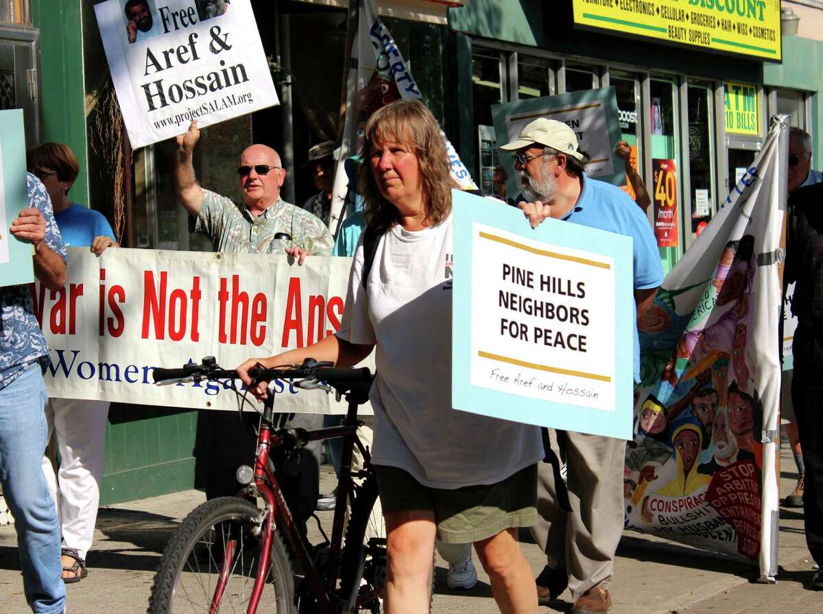 Vicki Weiss of Albany, center, marches with the Muslim Solidarity Committee to support freedom for Yassin Aref and Mohammed Hossain on Monday, August 4, 2014, in Albany N.Y. (Selby Smith/Special to the Times Union)
