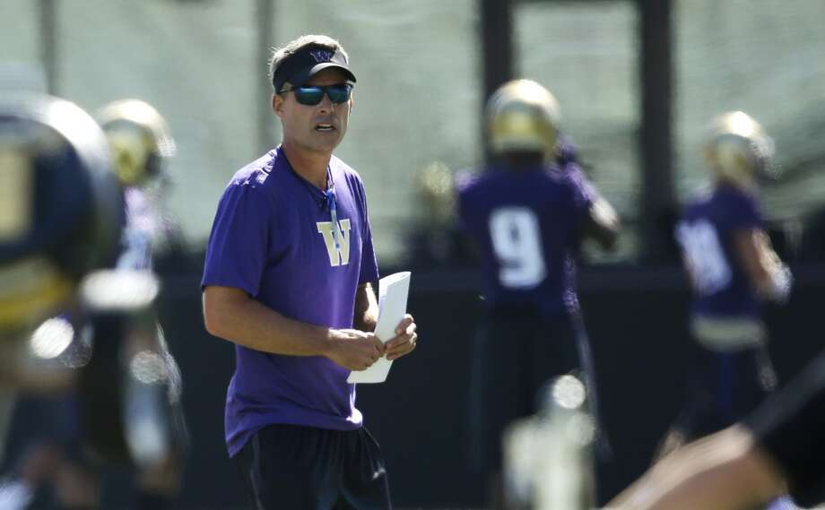 """1. Petersen's first campWhen the university introduced Petersen as the Huskies new coach on December 9, the expectations for the program were immediately ratcheted up. The team had certainly undergone incremental improvement in five years under Sarkisian, but — after hiring arguably the most sought-after coach in the country over the last several seasons — it was clear that winning eight games and qualifying for a bowl would no longer be good enough for UW.Peterson will be expected to lift the Dawgs into the national college football discussion, and he'll be expected to do it sooner rather than later — especially with a team that returns as much talent on paper as this Huskies team. Say what you will about """"Seven win Steve,"""" but Sarkisian could recruit, and the cupboard is hardly bare as Peterson takes over.If history is any indication, Petersen will handle the pressure just fine. After all, he led Boise State to an undefeated season and a win in the Fiesta Bowl in his first season at the helm for the Broncos. While no one will hold him to that standard in his Seattle debut, he will at least be expected to show the kind of improvement Sark displayed over the last several seasons. Photo: Ted S. Warren, Associated Press"""