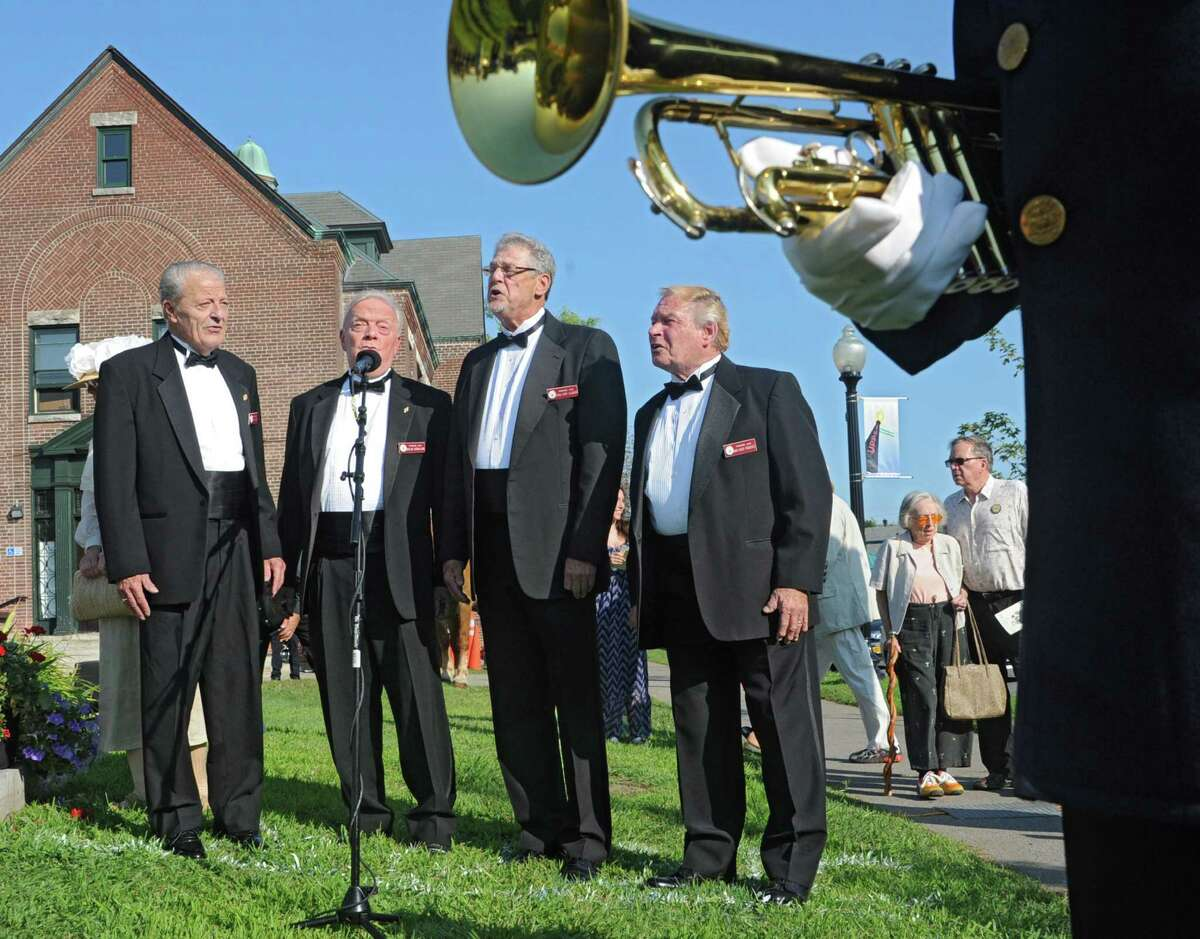 From left, members of The Primrose Lane Barbershop Quartet Bud Woolsey, Joe Cutshall-King, Gary Glidden and Chuck Packevicz sing at an event celebrating the O100th Anniversary of the Great War,O on Monday, Aug. 4, 2014 in Albany, N.Y. (Lori Van Buren / Times Union)
