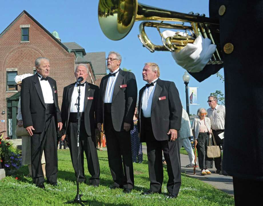 From left, members of The Primrose Lane Barbershop Quartet Bud Woolsey, Joe Cutshall-King, Gary Glidden and Chuck Packevicz sing at an event celebrating the O100th Anniversary of the Great War,O on Monday, Aug. 4, 2014 in Albany, N.Y. (Lori Van Buren / Times Union) Photo: Lori Van Buren / 00028044A