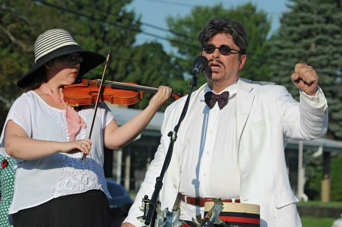 Violinist Jessica Belflower plays her violin as event director Michael Butler sings at an event celebrating the O100th Anniversary of the Great War,O on Monday, Aug. 4, 2014 in Albany, N.Y. (Lori Van Buren / Times Union)