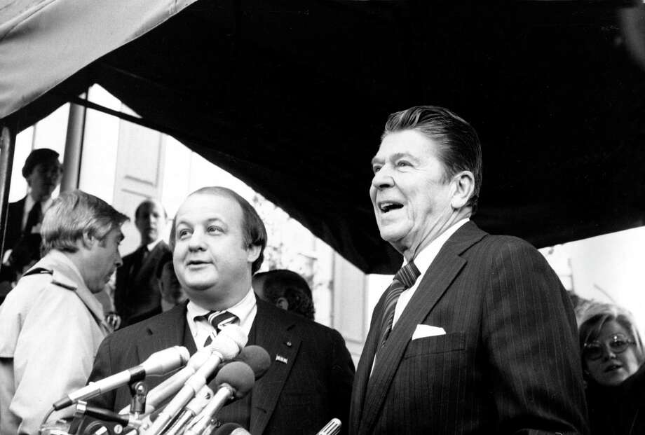 President-elect Ronald Reagan introduces James Brady as his press secretary less than three months before both were shot by John Hinckley in 1981. Photo: Associated Press / AP