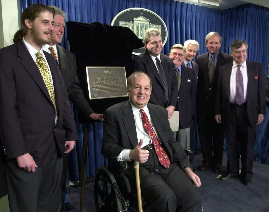 James Brady, the former press secretary for President Ronald Reagan,  was the center of attention  after the dedication ceremony for the James S. Brady Press Briefing Room in February 2000. Photo: SUSAN WALSH, STF / AP