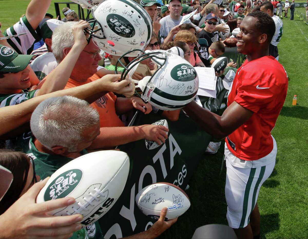 New York Jets quarterback Geno Smith signs autographs for fans after practice during an NFL football training camp on Saturday, July 26, 2014, in Cortland, N.Y. (AP Photo/Frank Franklin II) ORG XMIT: NYFF109