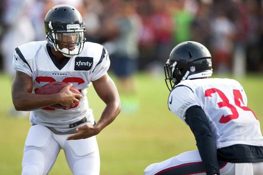 Brandon Harris, left, and A.J. Bouye are in the running for the backup cornerback spots behind Johnathan Joseph and Kareem Jackson and will be judged solely by what they show the Texans' new coaching staff. Photo: Brett Coomer, Staff / © 2014 Houston Chronicle