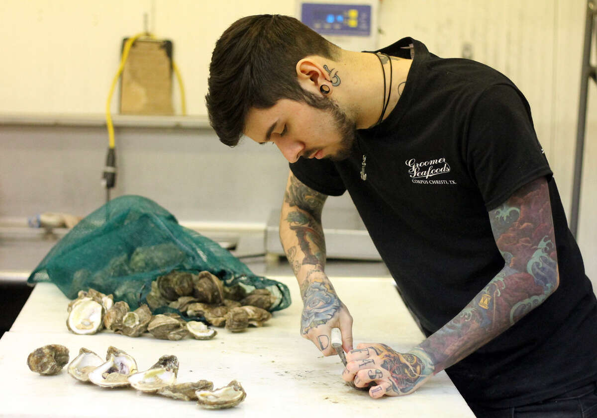 Blake Groomer shucks Texas Gulf Coast oysters at Groomer Seafood. The Gulf is seeing a shortage of oysters.
