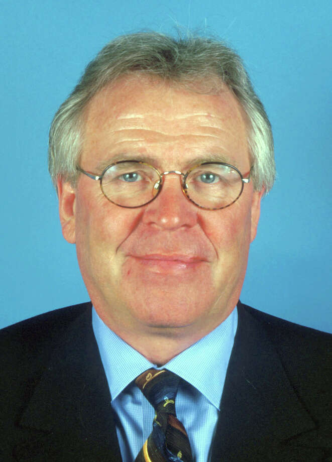 ** FILE ** This is a 2002 file photo of New York Rangers president and general manager Glen Sather.  Sather took over as coach of the team Thursday, Jan. 30, 2003, one day after he fired Bryan Trottier. Sather, who led the Edmonton Oilers to four Stanley Cup titles, dismissed Trottier on Wednesday night just 54 games into his rookie season as coach. Sather will lead the team for the remainder of the season.(AP Photo/File) / NHL