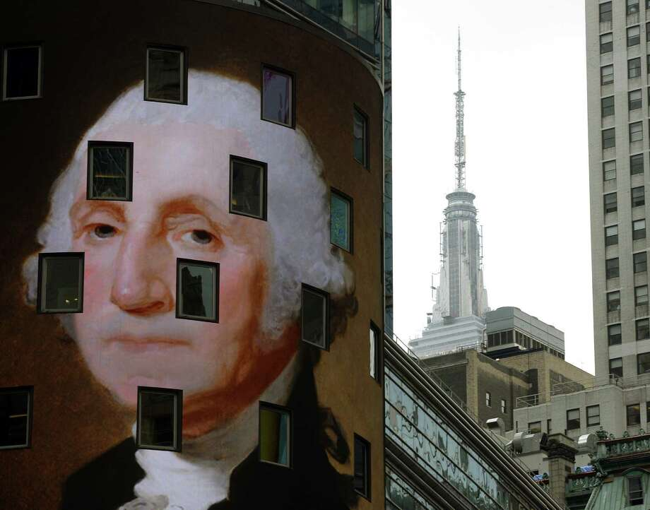 """The work """"George Washington, c. 1821"""" by Gilbert Stuart, is seen on the side of the NASDAQ building as part of the """"Art Everywhere US: A Very Very Big Art Show,"""" August 4, 2014 in Times Square in New York. A nationwide display of images of artwork will appear in public locations beginning August 4, and continue throughAugust 31. Electronic billboards will display a rotating selection of the 58 images of classic and contemporary American artworks during the same time frame. Photo: TIMOTHY A. CLARY, AFP/Getty Images / AFP"""