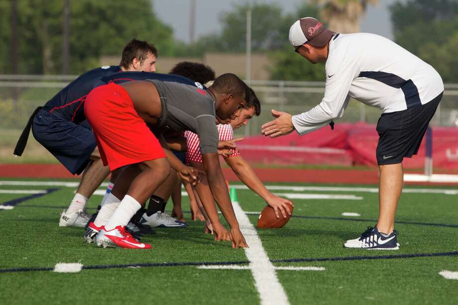 Members of the Dawson football team enjoyed the benefit of getting an early start on preseason practice after their program decided not to participate in spring drills. Photo: J. Patric Schneider, Freelance / © 2014 Houston Chronicle
