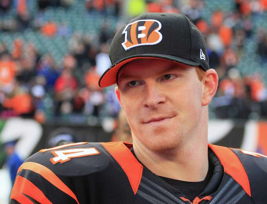 FILe - This Dec. 22, 2013 file photo shows Cincinnati Bengals quarterback Andy Dalton walking off the field after the Bengals defeated the Minnesota Vikings 42-14,  in Cincinnati. The  Bengals on Monday, Aug. 4, 2014, made Dalton one of the highest-paid quarterbacks in the league. Dalton signed a six-year extension. According to multiple reports, the deal is worth up to $115 million and will prevent Dalton playing out the final year of his rookie contract. (AP Photo/Tom Uhlman, File) Photo: Tom Uhlman, FRE / FR31154 AP