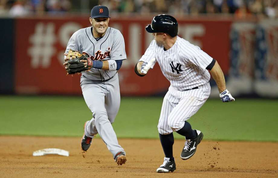 Tigers shortstop Eugenio Suarez, left, chases the Yankees' Brett Gardner after catching Gardner in a rundown for an out in Monday's game at Yankee Stadium. Photo: Kathy Willens, STF / AP