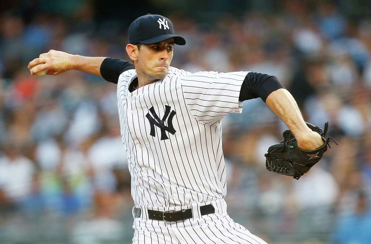 NEW YORK, NY - AUGUST 04: Brandon McCarthy #38 of the New York Yankees pitches in the first inning against the Detroit Tigers at Yankee Stadium on August 4, 2014 in the Bronx borough of New York City. (Photo by Mike Stobe/Getty Images) ORG XMIT: 477587413