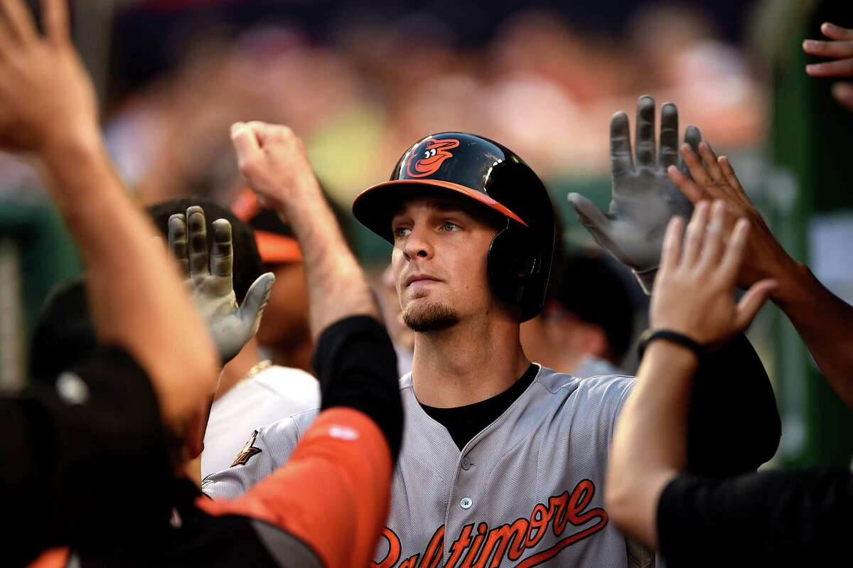 WASHINGTON, DC - AUGUST 04: Caleb Joseph #36 of the Baltimore Orioles is met in the dugout by teammates after hitting a solo home run in the third inning against the Washington Nationals at Nationals Park on August 4, 2014 in Washington, DC. (Photo by Patrick Smith/Getty Images) ORG XMIT: 502270165