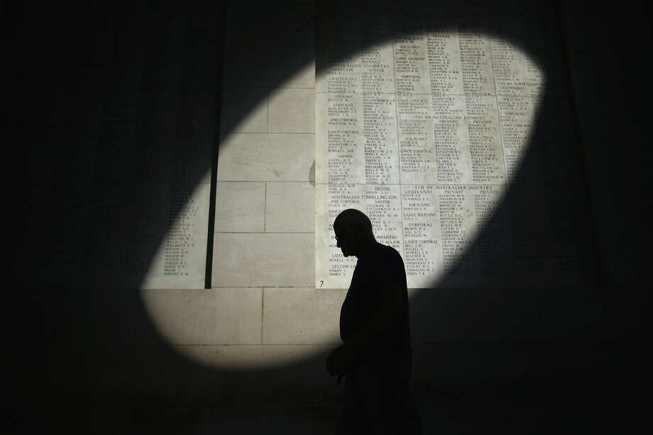 YPRES, BELGIUM - AUGUST 04:  A shaft of sunlight falls on the names of the missing at the Menin Gate Memorial on the centenary of the Great War on August 4, 2014 in Ypres, Belgium. Today marks the 100th anniversary of Great Britain declaring war on Germany. In 1914 British Prime Minister Herbert Asquith announced at 11 pm that Britain was to enter the war after Germany had violated Belgium neutrality. The First World War or the Great War lasted until 11 November 1918 and is recognised as one of the deadliest historical conflicts with millions of causalities. A series of events commemorating the 100th anniversary are taking place throughout the day.  (Photo by Christopher Furlong/Getty Images) *** BESTPIX *** Photo: Christopher Furlong, Getty Images