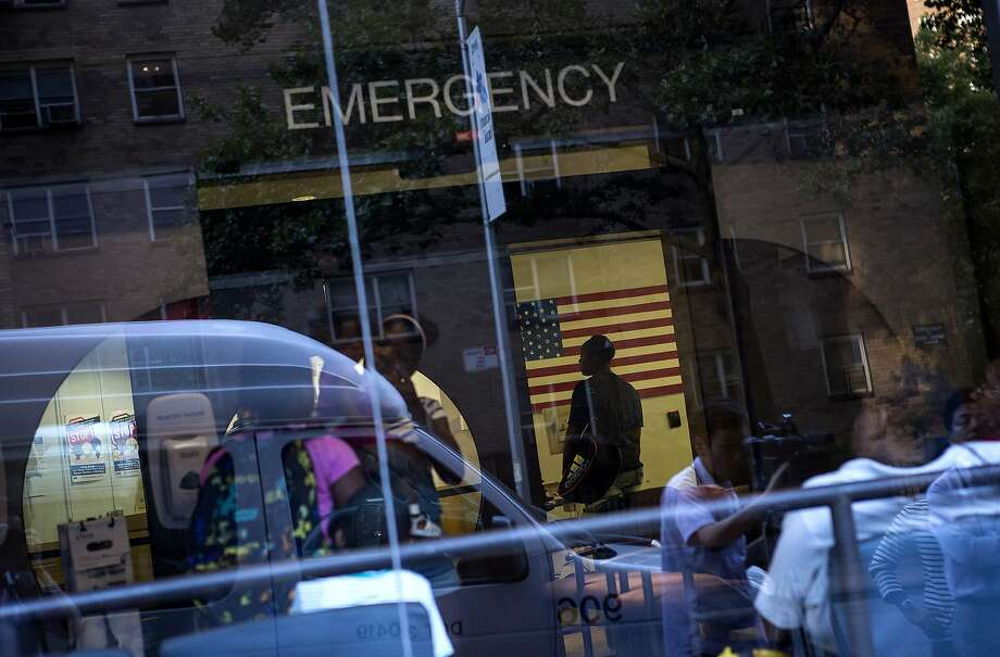 NEW YORK - AUGUST 4: People stand in the emergency room at Mount Sinai Hospital on August 4, 2014 in New York City. Doctors at the Manhattan-located hospital were reportedly testing a man who had recently returned from West Africa for the Ebola virus. (Photo by Eric Thayer/Getty Images) Photo: Eric Thayer, Getty Images
