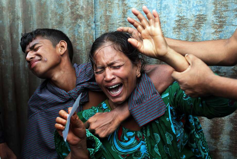 Bangladeshi woman Munni, whose daughters are missing, cries as rescuers search the River Padma after a passenger ferry capsized in Munshiganj district, Bangladesh, Monday, Aug. 4, 2014. A passenger ferry carrying hundreds of people capsized Monday in central Bangladesh, and at least 44 people either swam to safety or were rescued, but the number of missing passengers is not yet known. (AP Photo/ A.M. Ahad) Photo: A.M. Ahad, Associated Press