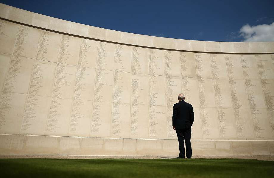 STAFFORD, ENGLAND - AUGUST 04:  A man looks upon the names of the dead prior to a Candlelit Vigil to mark the centenary of the First World War, at The National Memorial Arboretum on August 4, 2014 in Stafford, England. Monday 4th August marks the 100th anniversary of Great Britain declaring war on Germany. In 1914 British Prime Minister Herbert Asquith announced at 11pm that Britain was to enter the war after Germany had violated Belgium neutrality. The First World War or the Great War lasted until 11 November 1918 and is recognised as one of the deadliest historical conflicts with millions of causalities. A series of events commemorating the 100th anniversary are taking place throughout the day.  (Photo by Dan Kitwood/Getty Images) *** BESTPIX *** Photo: Dan Kitwood, Getty Images