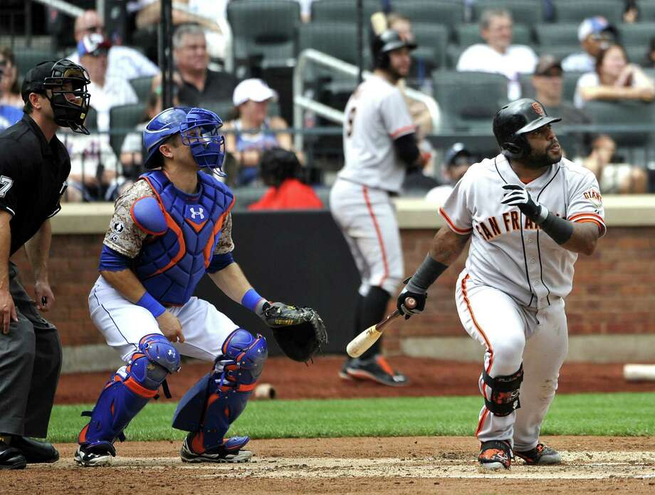 Giants third baseman Pablo Sandoval hits a two-run double as Mets catcher Travis d'Arnaud looks on. Photo: Kathy Kmonicek / Associated Press / FR170189 AP