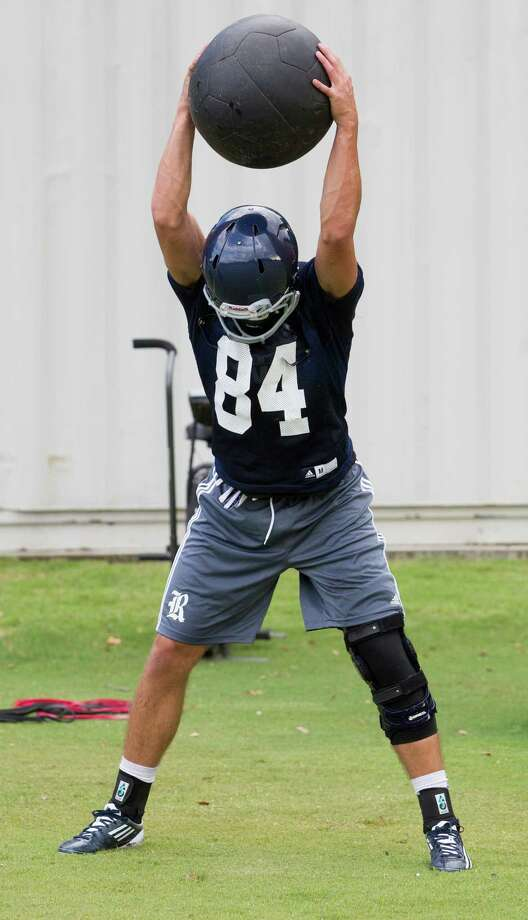 Rice's Trevor Long works out during practice on Monday, Aug. 4, 2014, in Houston. Photo: J. Patric Schneider, For The Chronicle / © 2014 Houston Chronicle