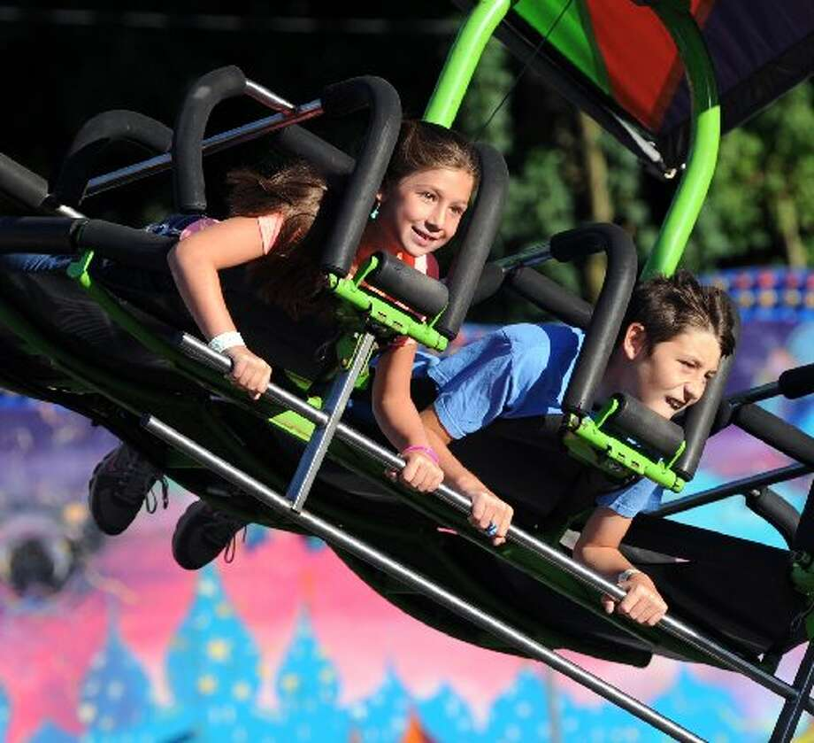 Kids get their thrills on this ride offered at the Carnival of Fun in Riverside.Photo by Bob Luckey.