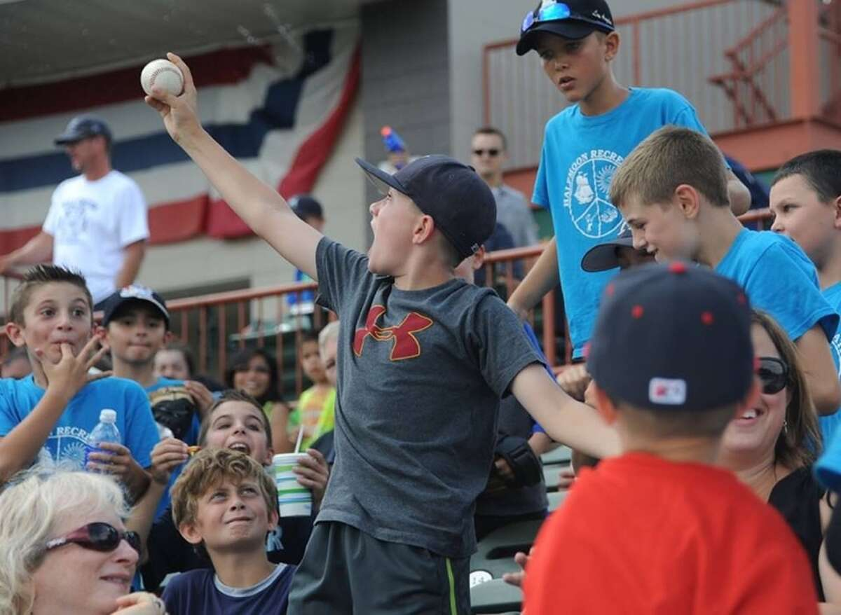 Tri-City ValleyCats fan Aidan Ryan, 10, of Clifton Park catches a ball thrown into the stands during a baseball game against the Batavia Muckdogs at the Joe Bruno Stadium on Monday, Aug. 4, 2014 in Troy, N.Y. Aidan was watching the game with the Halfmoon Recreation camp. (Lori Van Buren / Times Union)