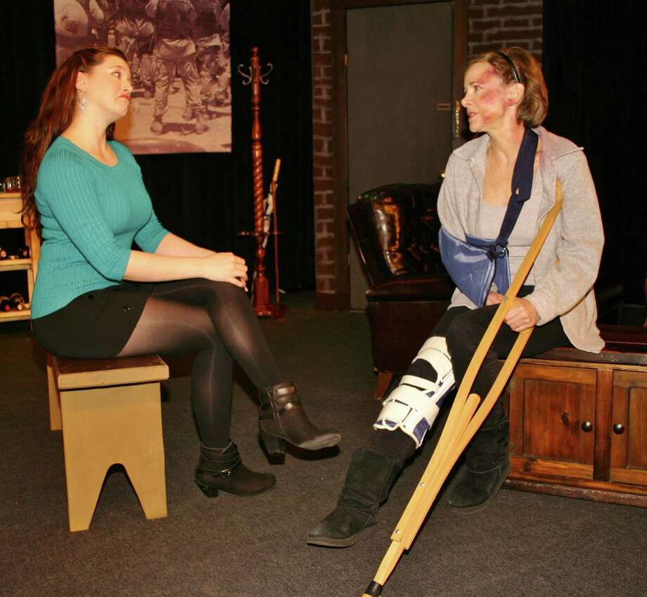 "Janet Rathert, of New Canaan, right, - with Stratford's Alisson Wood in a scene from Square One Theatre Company's production of ""Time Stands Still"" - won outstanding actress in the Subscriber Awards for her role in the play. Photo: Contributed Photo, Contributed / New Canaan News Contributed"