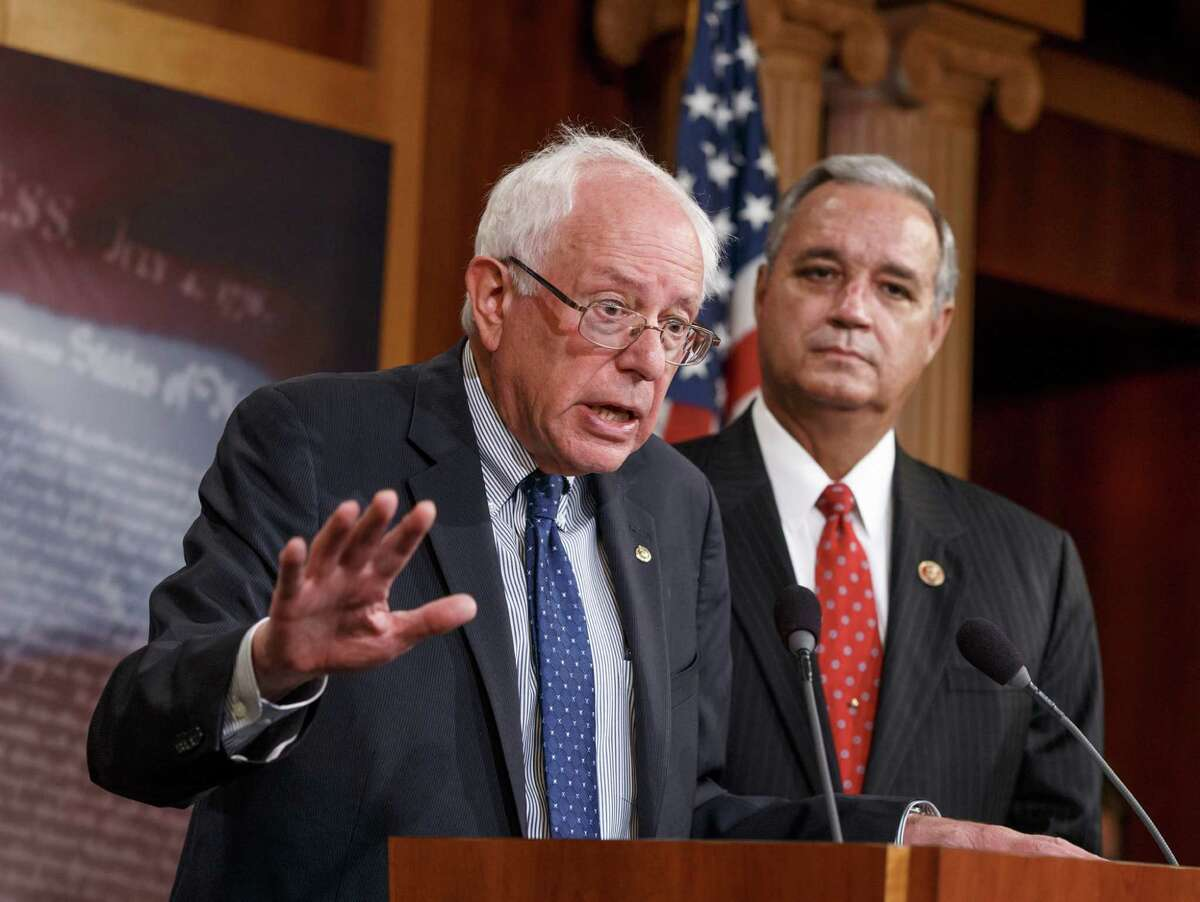 Senate Veterans' Affairs Chairman Sen. Bernie Sanders, I-Vt., left, accompanied by House Veterans' Affairs Chairman Rep. Jeff Miller, R-Fla., speaks during a news conference on Capitol Hill in Washington, Monday, July 28, 2014, to outline their agreement on a compromise plan to fix the vast health care system responsible for treating the nation's veterans. A bipartisan deal to improve veterans' health care would authorize at least $17 billion to fix the health program scandalized by long patient wait times and falsified records covering up delays, the bill's chief supporters said Monday. (AP Photo/J. Scott Applewhite)