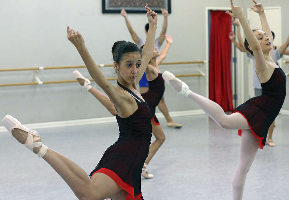 Danae Quevedo performs with other dancers as Ballet Latino de San Antonio rehearses. Photo: Photos By Tom Reel / San Antonio Express-News / San Antonio Express-News