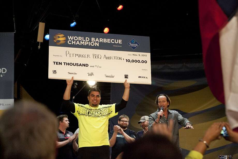 Victor Howard of Houston's Pitmaker BBQ Addiction holds the check his team won at the 2013 World Barbecue Championship in Las Vegas. Photo: FYI TV