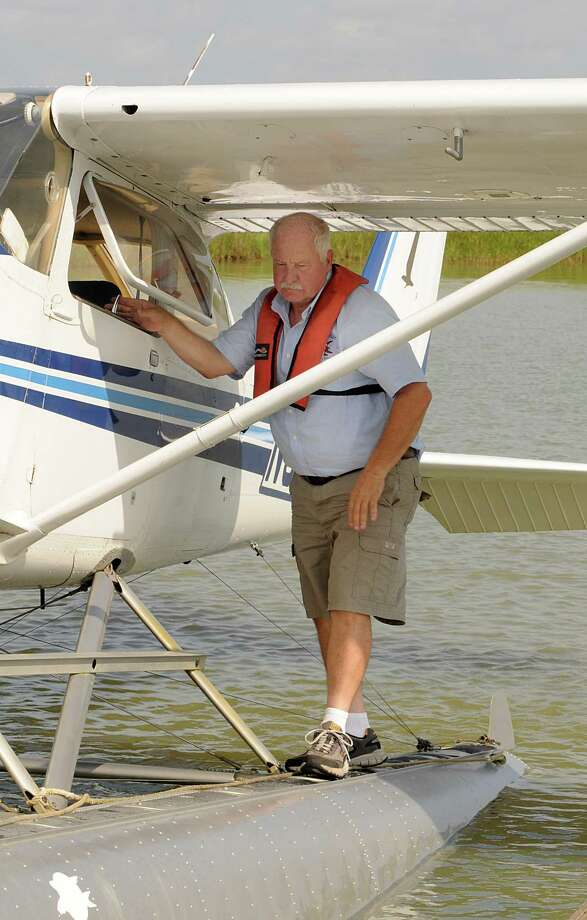 Terry Sonday makes a final check before taking off in his seaplane. Photo: David Hopper, Freelance / freelance
