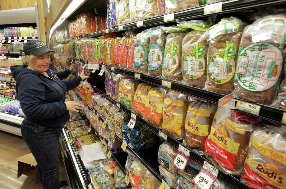 Tammy Smith stacked a display of bread at Sprouts Farmers Market at 22506 Tomball Parkway in 2013. Photo: Melissa Phillip, Staff / © 2013  Houston Chronicle