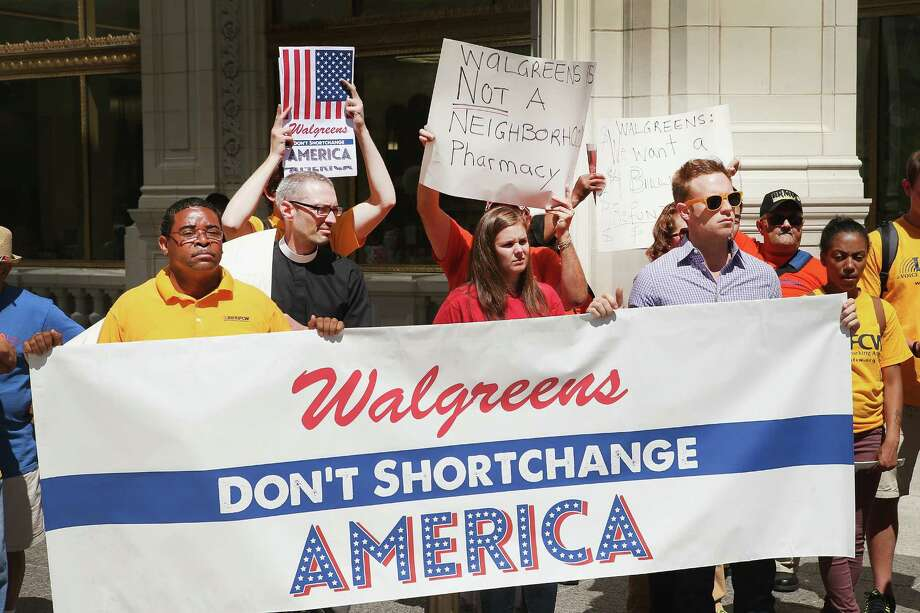 Demonstrators last month protest in Chicago against the possibility of Walgreen Co. reincorporating itself overseas to lower its tax bill. Photo: Scott Olson, Staff / 2014 Getty Images