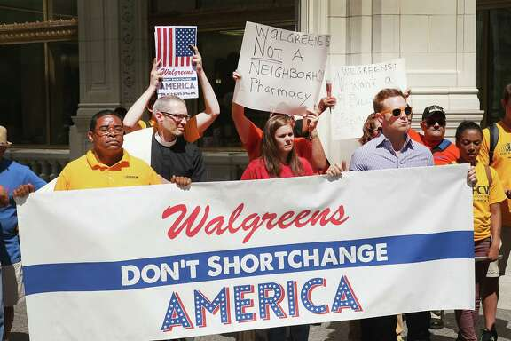 Demonstrators last month protest in Chicago against the possibility of Walgreen Co. reincorporating itself overseas to lower its tax bill.