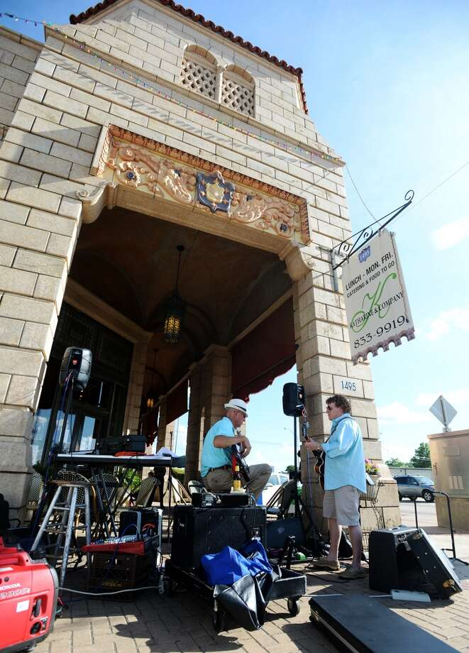 Mickey Rouse, left, and Josh Crawford warm up their instruments outside the Mildred Building on Thursday afternoon. The sidewalks along the Mildred Building were dotted with vendors, shoppers, and musicians during First Thursday on June 5. Cheap vendors spots are available along the sidewalk of Calder Avenue during the monthly event, and live music is accompanied by food and drink.