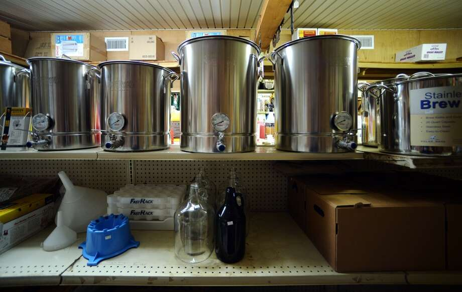 Brewing supplies sit on a back shelf at Mid County Farm and Feed Supply in Nederland, TX, on Tuesday afternoon. The shop has devoted a section of their store to home brewing. Photo taken Tuesday, 1/7/14 Jake Daniels/@JakeD_in_SETX