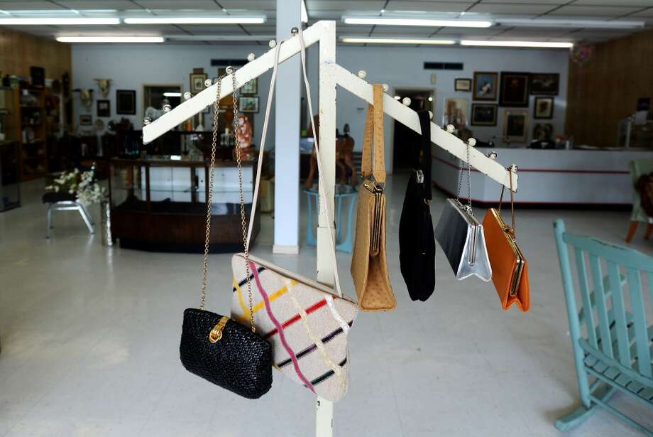 Handbags hang from a rack at Grandma's Basement on Thursday afternoon. The new store will specialize in antiques and resale goods, and will open for business Saturday, March 22, 2014. Photo taken Thursday, 3/20/14 Jake Daniels/@JakeD_in_SETX