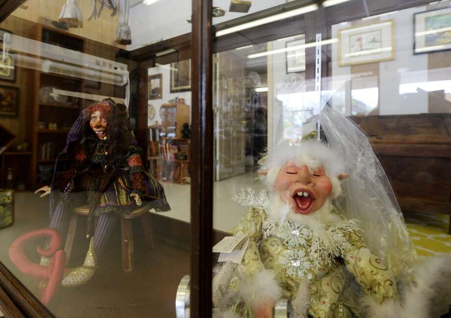 Dolls sit in a display case at Grandma's Basement on Calder Avenue on Thursday afternoon. Grandma's Basement, a new store specializing in antiques and resale goods, will open for business Saturday, March 22, 2014. Photo taken Thursday, 3/20/14 Jake Daniels/@JakeD_in_SETX
