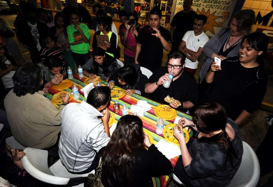 Tacos La Bamba held its first couples food eating competition as a First Thursday event on Thursday, February 7, 2013. Photo taken: Randy Edwards/The Enterprise
