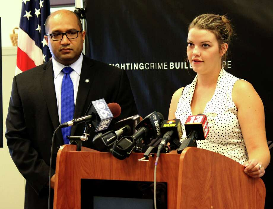Albany District Attorney David Soares, left, and Christine, a former victim of sex trafficking, right, discuss the issues of prostitution and sex trafficking in Albany County on Tuesday morning, Aug. 5, 2014, during a press conference in Albany N.Y. (Selby Smith/Special to the Times Union) Photo: Selby Smith / 00028043A