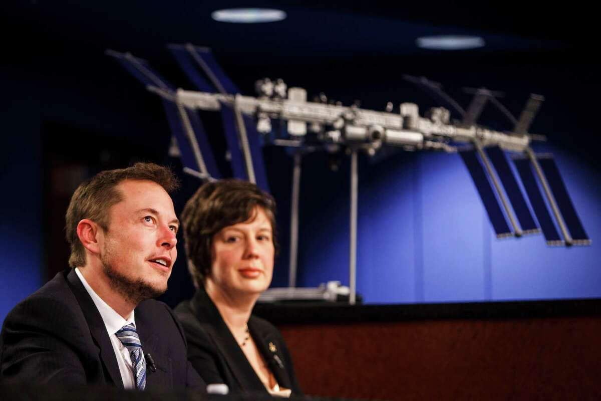 Elon Musk, CEO of SpaceX, (left) fields questions while sitting beside Holly Ridings, NASA Flight Director (right) during a press conference involving NASA and SpaceX officials to discuss the upcoming SpaceX Demonstration Mission after a flight readiness review of a Dragon spacecraft flying to the International Space Station, at Johnson Space Center, Monday, April 16, 2012, in Houston.