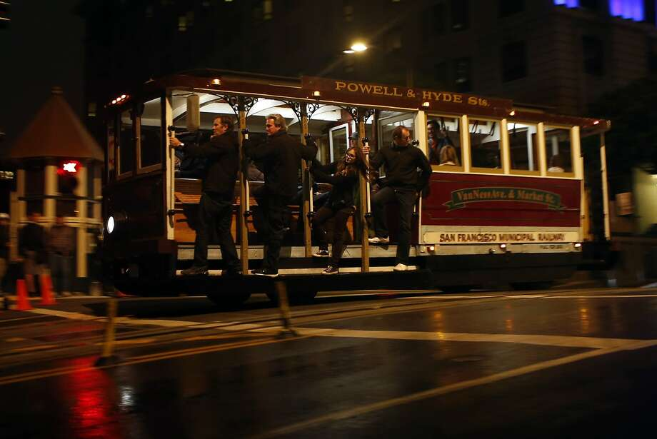 Movie extras hold onto a cable car during an action scene during the filming of Terminator: Genesis on California St. in San Francisco, Calif. on Monday, August 4, 2014. Photo: Scott Strazzante, The Chronicle