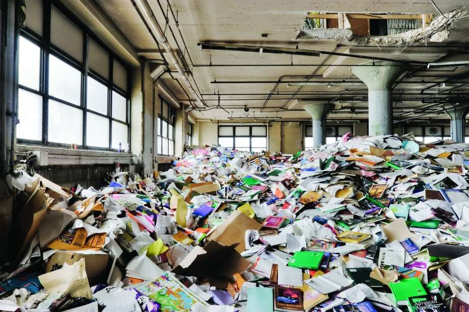 Discarded school supplies, textbooks and maps were emptied out of classrooms to make way for construction of Westinghouse College Prep School at the same site. Photo: Eric Holubow