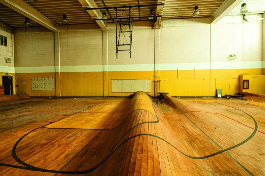 Warped gymnasium floor at the original Central Visual and Performing Arts High School in St. Louis. Founded in 1853, Central is the oldest public high school west of the Mississippi River. Photo: Eric Holubow