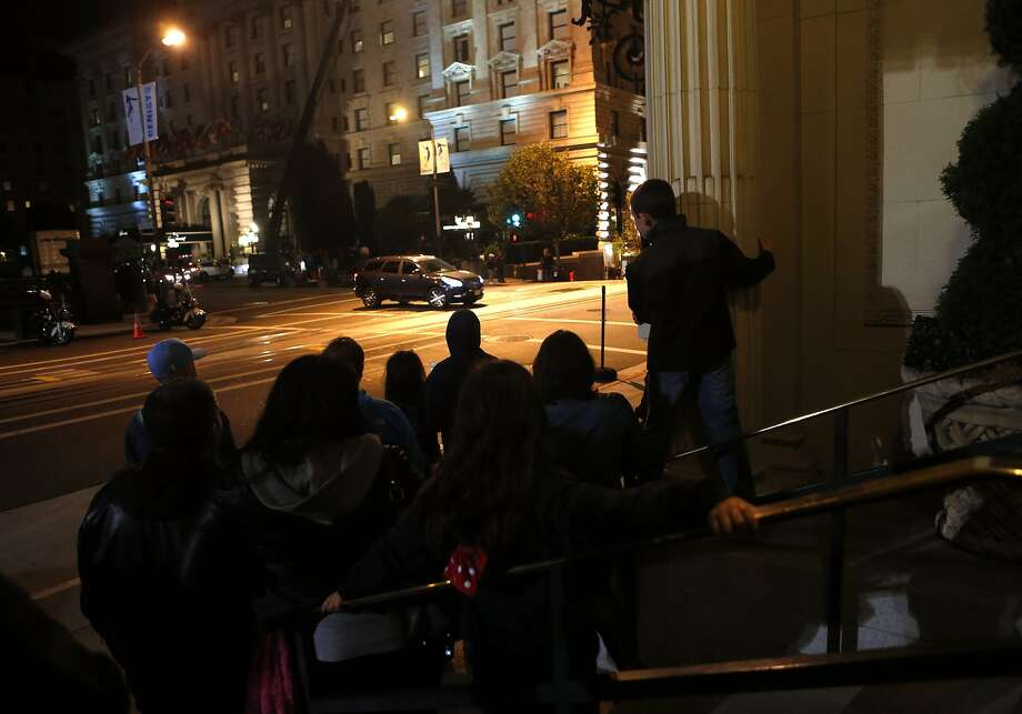 Members of the public watch the filming of Terminator: Genesis at the corner of Mason Street and California St. in San Francisco, Calif. on Monday, August 4, 2014. Photo: Scott Strazzante, The Chronicle