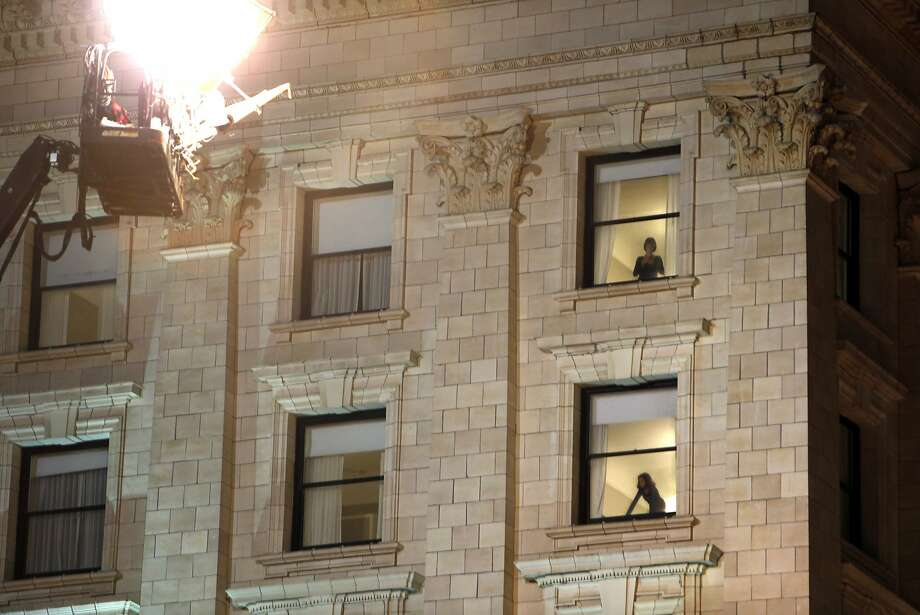 Fairmont Hotel guests watch filming of Terminator: Genesis below them at the corner of Mason Street and California Street in San Francisco, Calif. on Monday, August 4, 2014. Photo: Scott Strazzante, The Chronicle
