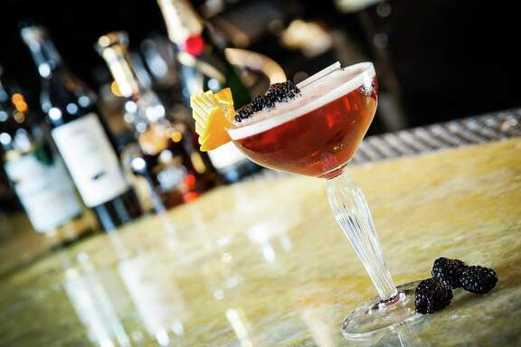 The Interlude, a cocktail made with blackberry liqueur, is served at 2014's Tales of the Cocktail in New Orleans.