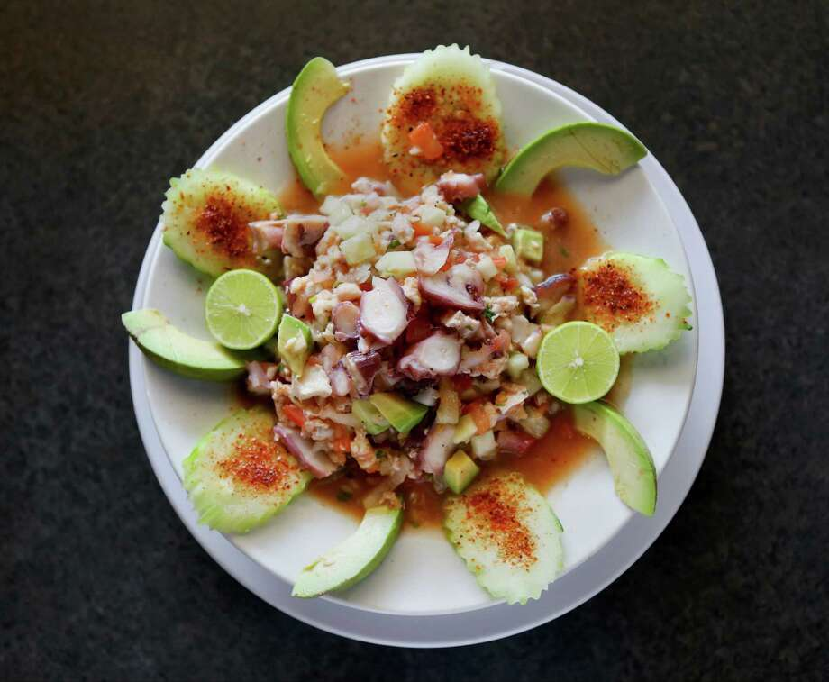 Cucumber, red onion and chile powder go into this shrimp and octopus ceviche. Photo: Timothy Tai, Staff Photographer / © 2014 San Antonio Express-News