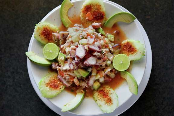 Cucumber, red onion and chile powder go into this shrimp and octopus ceviche.