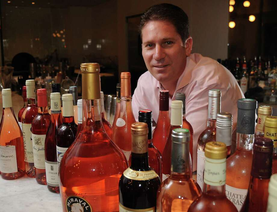 Brasserie 19 manager and wine buyer Shawn Virene shows the large selection of rosés. Photo: Dave Rossman, Freelance / © 2014 Dave Rossman